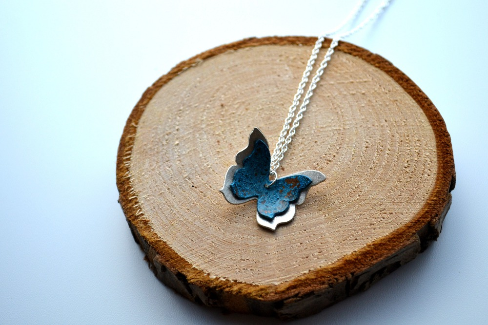 Silver and copper butterfly necklace