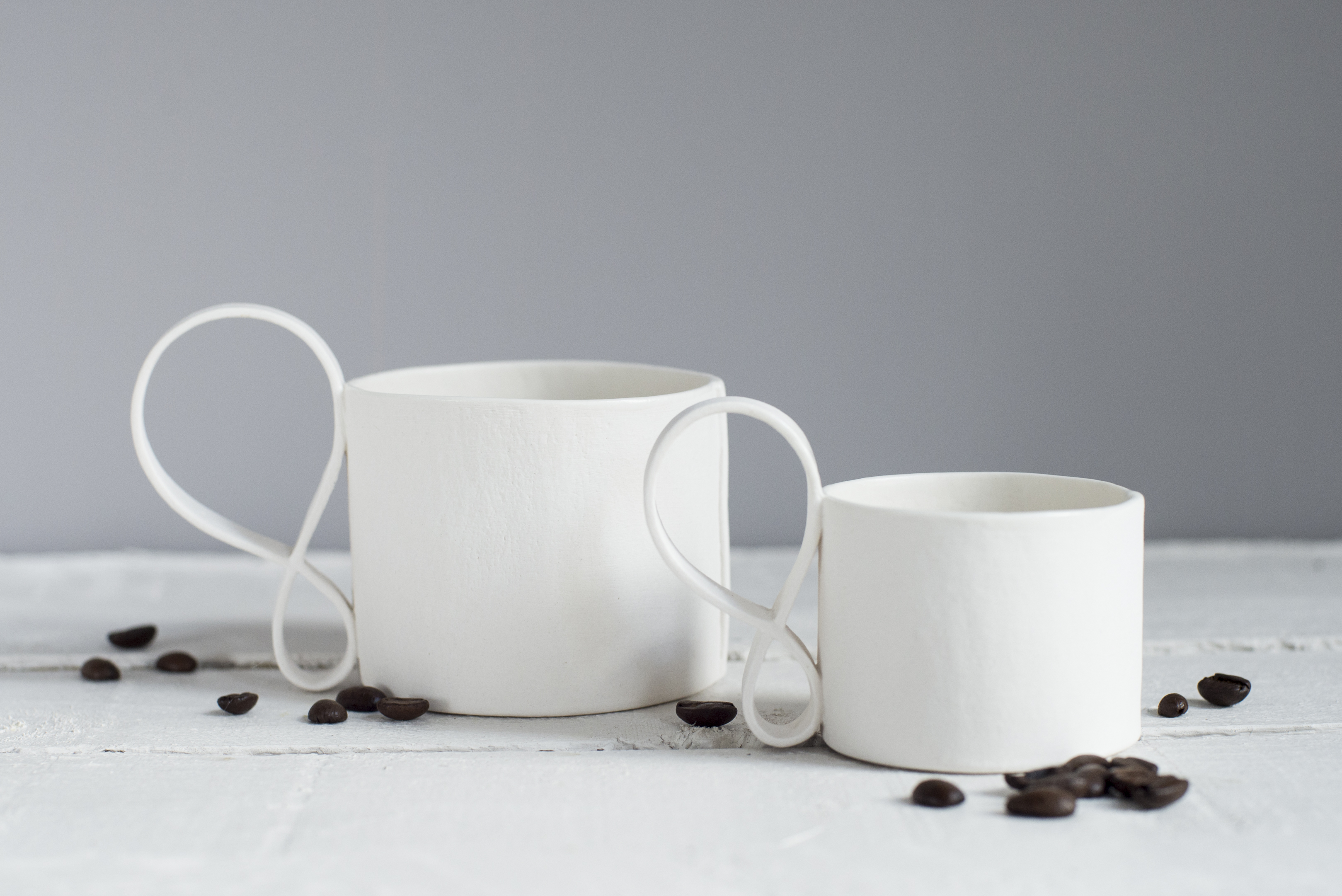 Porcelain Mug and espresso cup with swirl detail handles