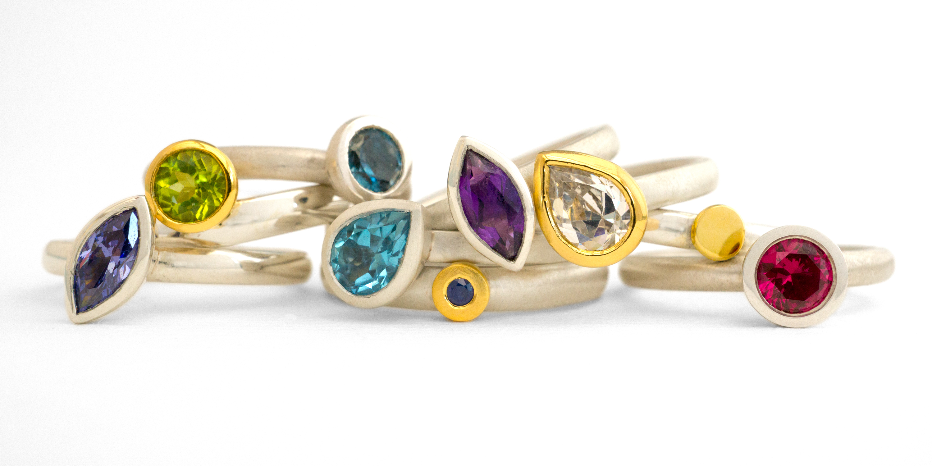 Silver, 18 carat gold and gemstone rings